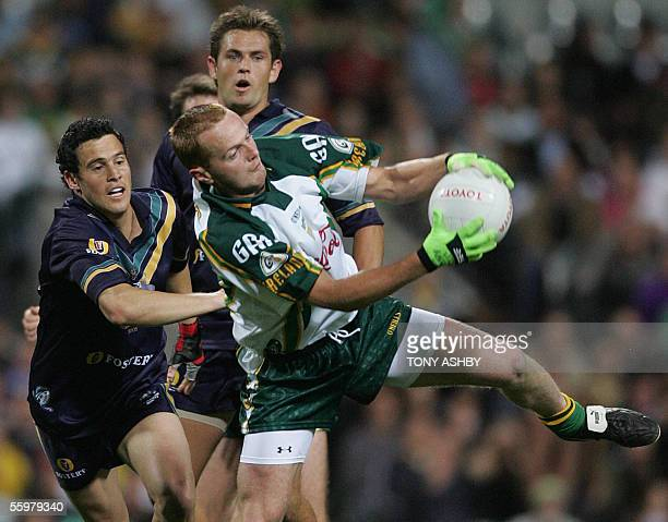 Irish forward Brendan Coulter marks a ball in front of Australian defenders during the International Rules football match at Subiaco Oval in Perth 21...