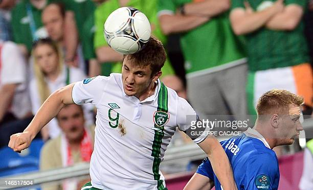 Irish forward Kevin Doyle heads the ball during the Euro 2012 football championships match Italy vs Republic of Ireland on June 18 2012 at the...