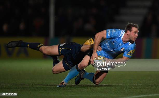 Irish fullback Greig Tonks releases the ball despite the attentions of Chris Pennell during the Aviva Premiership match between Worcester Warriors...