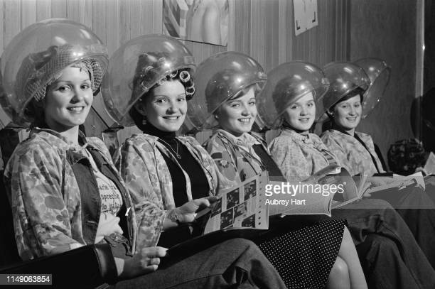Irish girl group The Nolan Sisters at an hairdresser UK 6th November 1975 they are Maureen Anne Bernie Linda and Denise Nolan