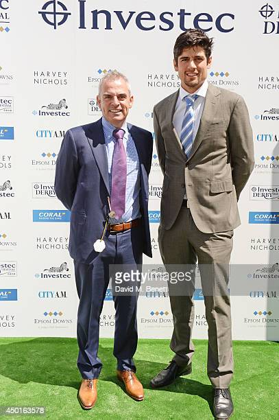 Irish golfer Paul McGinley and English cricket player Alastair Cook attends Ladies Day at the Investec Derby Festival at Epsom Downs Racecourse on...