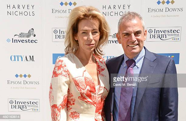 Irish golfer Paul McGinley and wife Alison attend Ladies Day at the Investec Derby Festival at Epsom Downs Racecourse on June 6 2014 in Epsom England