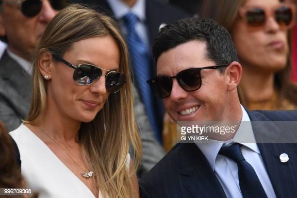 Irish golfer Rory McIlroy and wife Erica sit on centre court to watch Serbia's Novak Djokovic play Japan's Kei Nishikori during their men's singles...