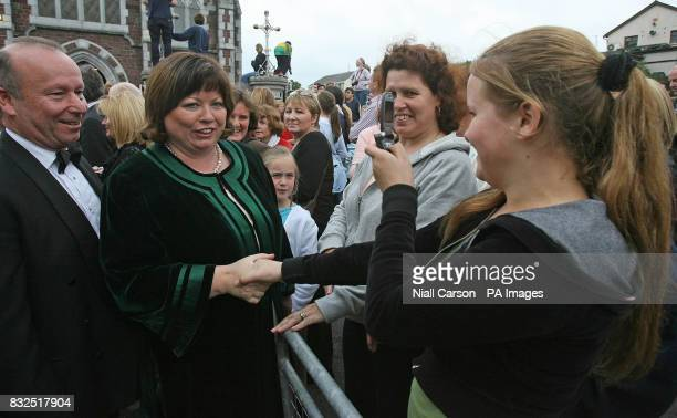 Irish Health Minister Mary Harney and her husband meet local people as they arrive for the wedding of River Dance star Michael Flatley and dancer...