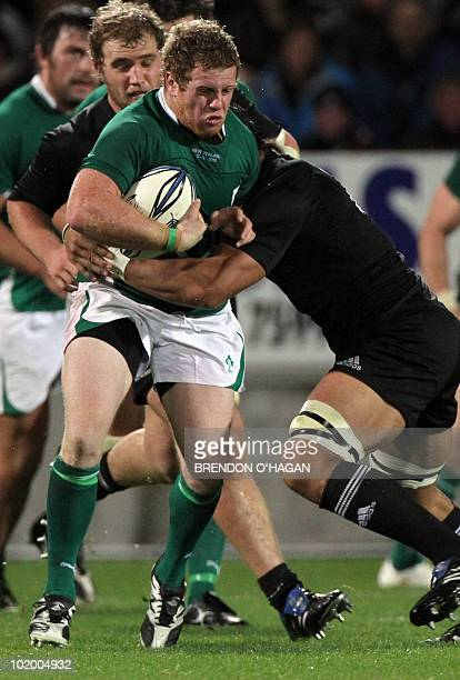 Irish hooker Sean Cronin tries to ride a tackle during the Rugby Union Test match between the New Zealand All Blacks and Ireland at the Yarrows...