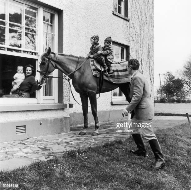 Irish horse trainer Vincent O'Brien and his family at home in Ballydoyle House Cashel Tipperary with 1954 Grand National winner Royal Tan March 1957...