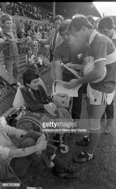 Irish International captain Laim Brady signs an autograph for Damien O'Donnell at Dalymount Park circa August 1982