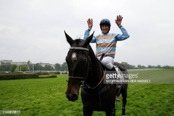 Irish jockey Davy Russell riding Carriacou reacts after winning the 141st edition of the Grand SteepleChase de Paris on May 19 at the Auteuil...