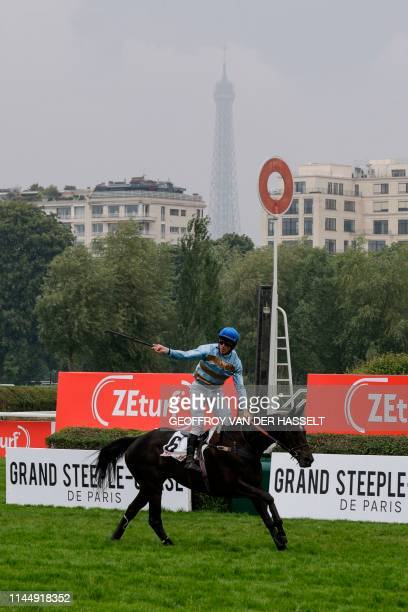Irish jockey Davy Russell riding Carriacou reacts as they cross the finish line to win the 141st edition of the Grand SteepleChase de Paris on May 19...