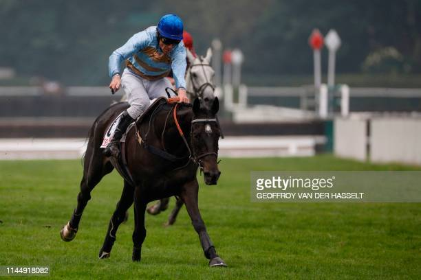 Irish jockey Davy Russell riding Carriacou sprint to the finish to win the 141st edition of the Grand SteepleChase de Paris on May 19 at the Auteuil...