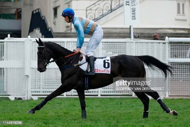 Irish jockey Davy Russell riding Carriacou warm up prior to competing in the 141st edition of the Grand SteepleChase de Paris on May 19 at the...