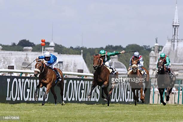 Irish jockey JohnPatrick Murtagh riding Prince Aga Khan's horse Valyra crosses the finish line to win the 163rd Prix de Diane horse racing on June 17...