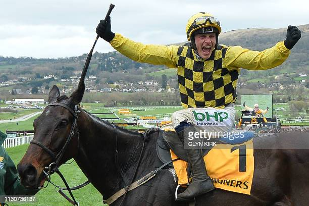 Irish jockey Paul Townend on Al Boum Photo reacts after winning the Gold Cup race on the final day of the Cheltenham Festival horse racing meeting at...