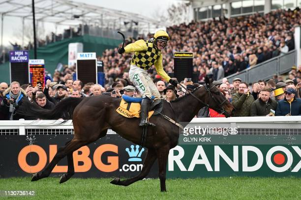 Irish jockey Paul Townend rides Al Boum Photo to win the Gold Cup race on the final day of the Cheltenham Festival horse racing meeting at Cheltenham...