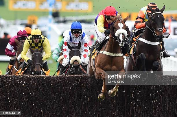 Irish jockey Paul Townend rides Al Boum Photo to win the Gold Cup race behind jockey Richard Johnson on Native River and jockey Nico De Boinville on...