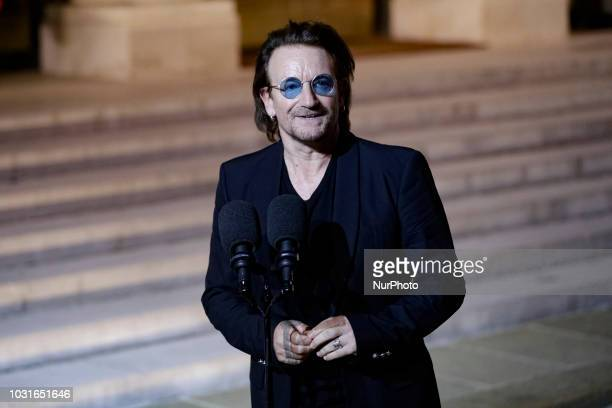 Irish lead singer of rock band U2, Paul David Hewson aka Bono delivers a statement in the courtyard of the Elysee Palace, in Paris, after a meeting...