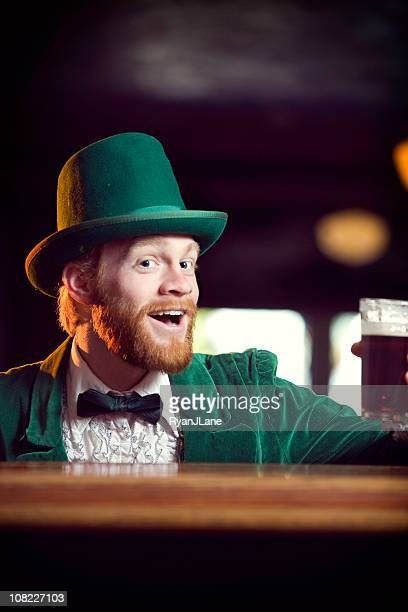 irish / leprechaun character series with pint of beer - leprechaun stock pictures, royalty-free photos & images