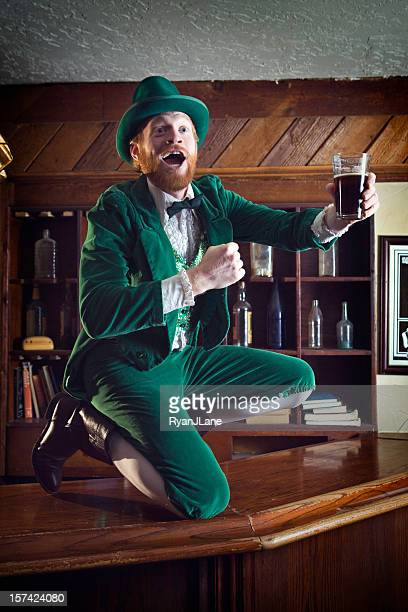 irish / leprechaun character with pint of beer - leprechaun stock pictures, royalty-free photos & images