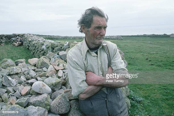 Irish Man Leaning Against a Stone Wall