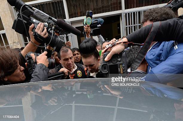 Irish Michaella McCollum who arrested on August 6 2013 at Lima's airport carrying cocaine in her luggage is escorted out of the Callao prosecutors...