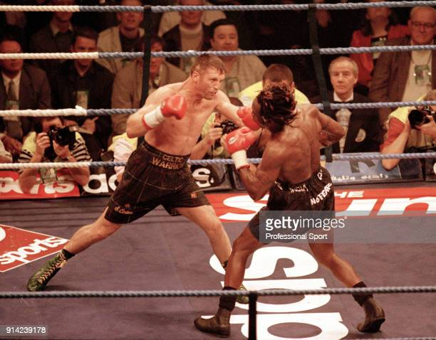 Irish middleweight and super middleweight boxer Steve Collins in action against Nigel Benn of Great Britain at the NYNEX Arena in Manchester on 9th...