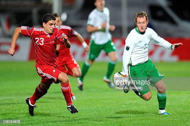 Irish midfielder Adrian McGeady vies with Andorra forward Alexander Martinez during the match Andorra vs Republic of Irland in their Euro 2012 group...