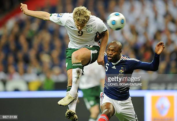 Irish midfielder Kevin Doyle fights for the ball with French defender William Gallas during the World Cup 2010 qualifying football match France vs...
