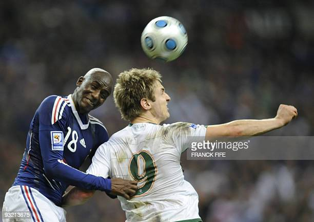 Irish midfielder Kevin Doyle fights for the ball with French forward Alou Diarra during the World Cup 2010 qualifying football match France vs...