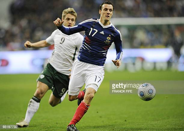 Irish midfielder Kevin Doyle vies with French defender Sebastien Squillaci during the World Cup 2010 qualifying football match France vs Republic of...