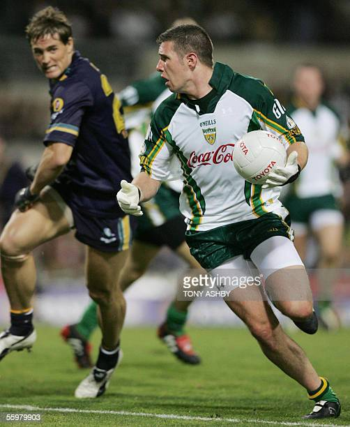 Irish midfielder Sean Cavanagh races away from Australian defender Trent Croad during the International Rules football match at Subiaco Oval in Perth...