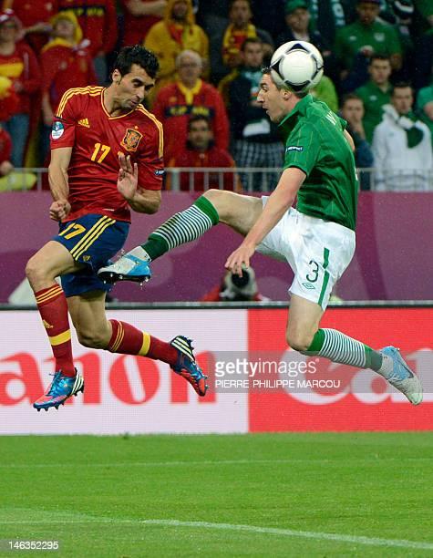 Irish midfielder Stephen Ward vies with Irish midfielder Stephen Hunt during the Euro 2012 championships football match Spain vs Republic of Ireland...