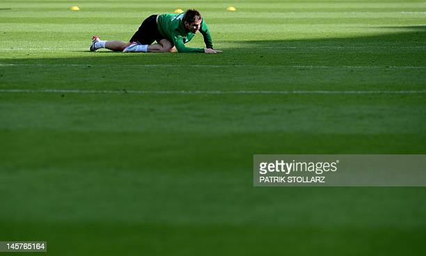 Irish midfielder Stephen Ward warms up during a training session at the Gdynia Arki stadium in Gdynia on June 5 2012 ahead of the Euro 2012 football...