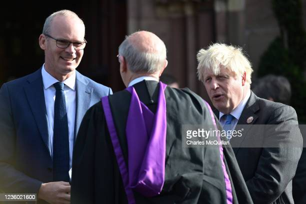 """Irish minister for foreign affairs, Simon Coveney and British Prime Minister, Boris Johnson chat with the clergy following a service of """"Reflection &..."""
