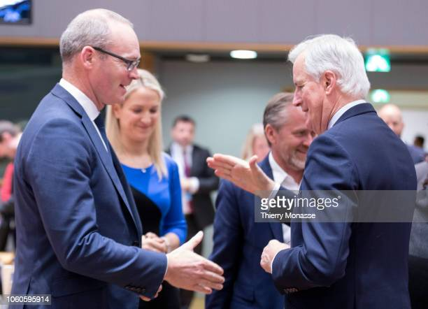 Irish Minister for Foreign Affairs Trade Simon Coveney is talking with the Irish Minister of State for European Affairs Helen McEntee the Danish...