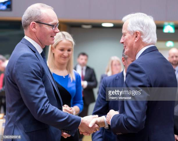 Irish Minister for Foreign Affairs Trade Simon Coveney is talking with the Irish Minister of State for European Affairs Helen McEntee and the...