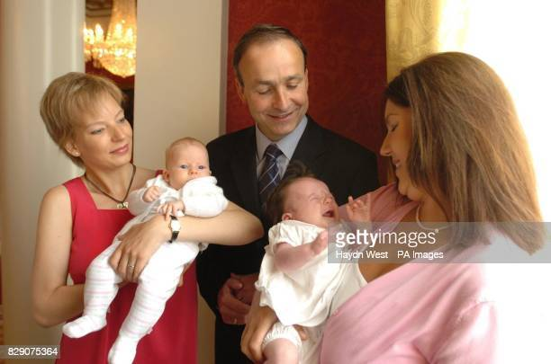 Irish Minister for Health Micheal Martin with Ms Liezel Shaun and baby Elaine and Ms Audrey Pugh and baby Molly at the launch of a European...