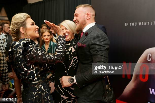 Irish mixed martial arts star Conor McGregor is greeted by his sister Erin upon arrival to attend the world premiere of the documentary film 'Conor...