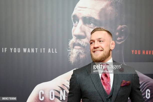 Irish mixed martial arts star Conor McGregor poses upon arrival to attend the world premiere of the documentary film 'Conor McGregor Notorious' at...