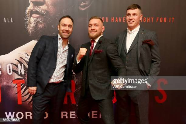 Irish mixed martial arts star Conor McGregor poses with producer Jamie D'Alton and Director Gavin Fitzgerald to attend the world premiere of the...