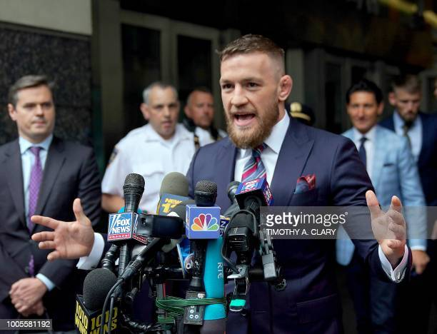Irish mixed martial arts superstar Conor McGregor talks to the press after he pleaded guilty to a single violation of disorderly conduct in Brooklyn...