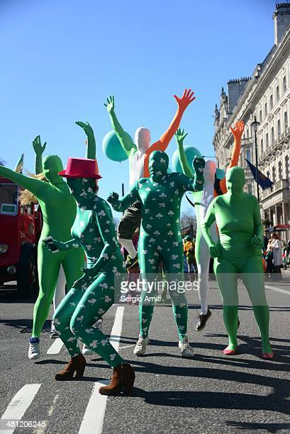 Irish morphsuits jumping in the air at the Saint Patrick's Day Parade in London