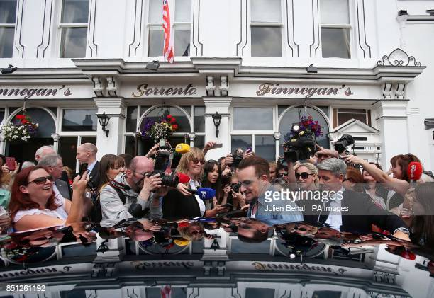 Irish musician Bono leaves Finnegan's Pub in Dalkey where he had lunch with the US First Lady Michelle Obama and his wife Ali