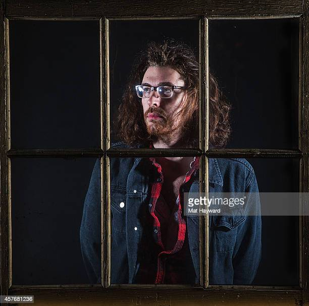 Irish musician Hozier poses for a portrait behind a window before performing an EndSession hosted by 1077 The End at Fremont Abbey Arts Center on...