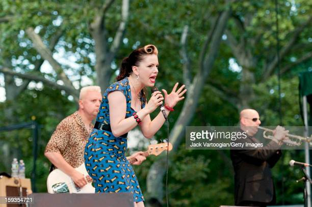 Irish musician Imelda May and her band which includes Alan Gare on bass guitar and Dave Priseman on trumpet perform on Central Park's SummerStage New...