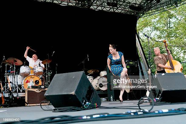 Irish musician Imelda May and her band which includes Stephen Rushton on drums and Alan Gare on bass perform on Central Park's SummerStage New York...