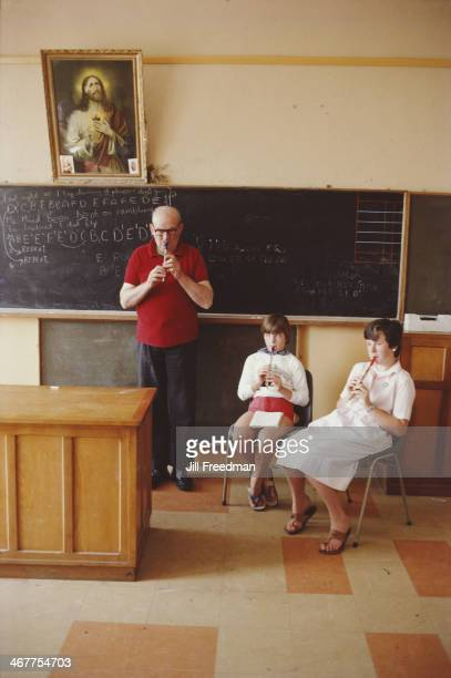 Irish musician Micho Russell gives a lesson on his tin whistle at a school in Ireland 1984