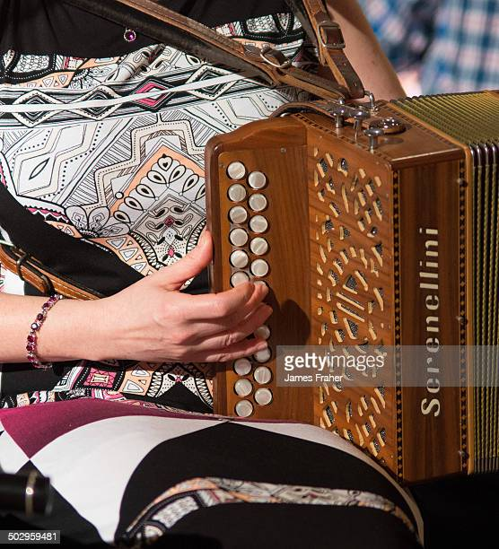 Irish musician performing on stage playing a Serenellini accordion at the Fleadh Gathering concert at the Southern Hotel on May 17 2014 in Sligo...