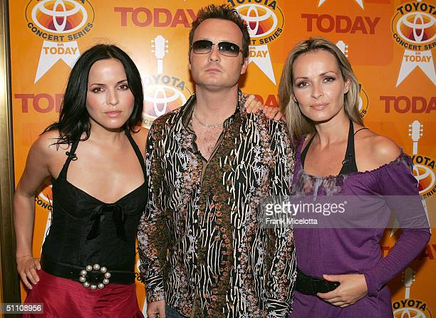 Irish musicians the Corrs, Andrea Corr, Jim Corr, and Sharon Corr, pose for a photo before performing on the 2004 Toyota Concert Series on the Today...