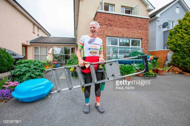 Irish Paralympic hopeful Leo Hynes who is legally blind brings a ladder to help him get inside his homemade training pool at home in Tuam Co Galway...