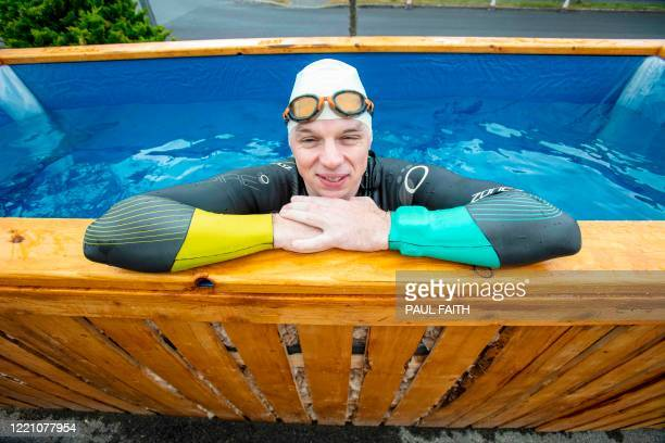 Irish Paralympic hopeful Leo Hynes who is legally blind poses in his homemade training pool at home in Tuam Co Galway west Ireland on June 18 2020 In...